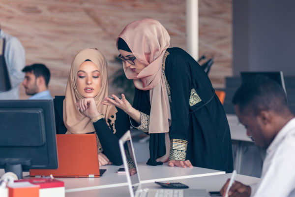 Two,Woman,With,Hijab,Working,On,Laptop,In,Office.